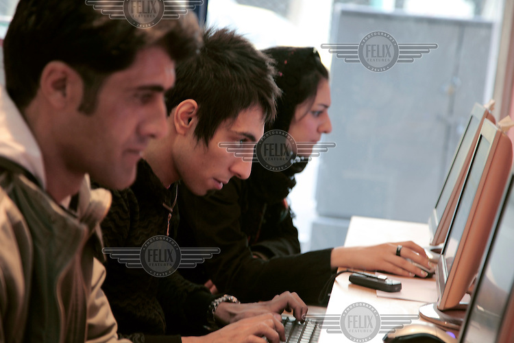 Customers in an internet cafe.