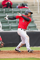 Cleuluis Rondon (5) of the Kannapolis Intimidators follows through on his swing against the Greenville Drive at CMC-Northeast Stadium on April 6, 2014 in Kannapolis, North Carolina.  The Intimidators defeated the Drive 8-5.  (Brian Westerholt/Four Seam Images)
