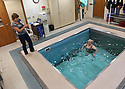 Patient Linda Fischer works with physical therapist Laura Warner on some deep water exercies in the pool facility at Harrison Hospital, Silverdale. The pool can very depth for water exercies, moving currents and has a treadmill for movement.  Brad Camp | For the Kitsap Sun