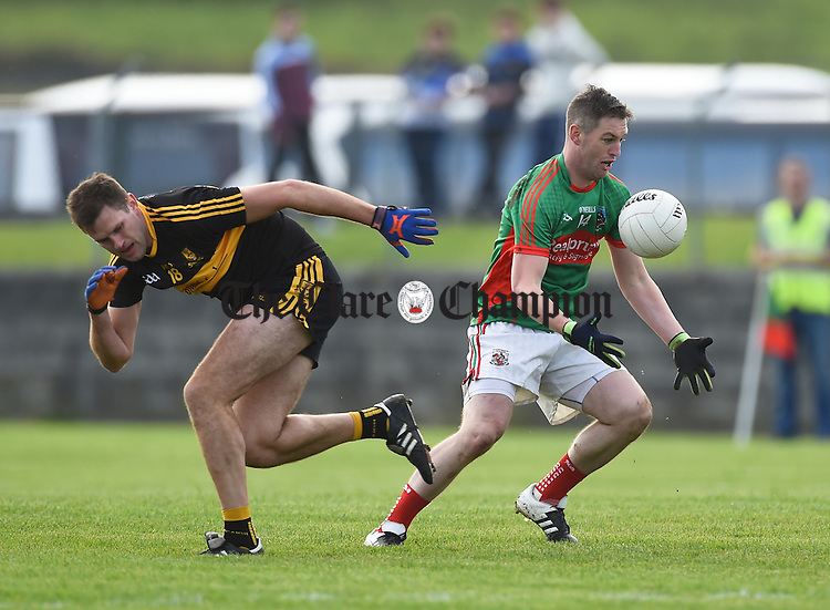Eoin Brosnan of  Dr. Crokes  in action against Enda Coughlan of  Kilmurry Ibrickane during their Munster Club championship game in Quilty. Photograph by John Kelly.