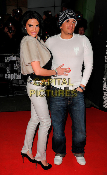 KATIE PRICE aka JORDAN & husband PETER ANDRE.Arrivals for the Capital Radio 95.8 FM Awards in aid of Help a London Child, held at Riverbank Park Plaza Hotel, London, England 20th March 2008. .full length grey skinny jeans fur coat jacket cropped black top belt heels shoes hat white married couple wife.CAP/CAN.©Can Nguyen/Capital Pictures