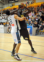 Taranaki's Marcus Campbell elbows Mike Karena out of his way. NBL - Taranaki Mountainairs v Nelson Giants at TSB Stadium, New Plymouth, New Zealand on Thursday, 28 April 2011. Photo: Dave Lintott / lintottphoto.co.nz