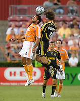 Houston Dynamo midfielder Dwayne De Rosario (14) and Columbus Crew midfielder Duncan Oughton (8) go up for the header. The Houston Dynamo tied the Columbus Crew 1-1 in a regular season MLS match at Robertson Stadium in Houston, TX on August 25, 2007.