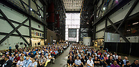 In this photo released by the National Aeronautics and Space Administration (NASA) United States Vice President Mike Pence, as seen on the monitor at right, addresses NASA employees, Thursday, July 6, 2017, at the Vehicle Assembly Building at NASAís Kennedy Space Center (KSC) in Cape Canaveral, Florida. The Vice President thanked employees for advancing American leadership in space, before going on a tour of the center that highlighted the public-private partnerships at KSC, as both NASA and commercial companies prepare to launch American astronauts from the multi-user spaceport. Photo Credit: Aubrey Gemignani/NASA/CNP/AdMedia