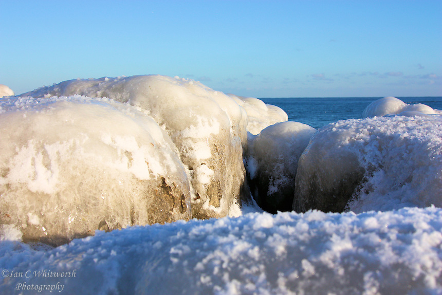 Ice covered rocks on the shore of Lake Ontario in Oakville