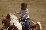 Young girl rides horse at the yearly Valle de Trinidad fiesta