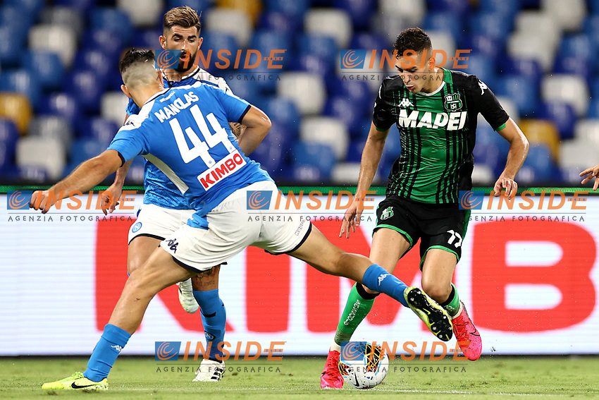 Konstantinos Manolas of SSC Napoli and Georgios Kyriakopoulos of US Sassuolo compete for the ball during the Serie A football match between SSC Napoli and US Sassuolo at stadio San Paolo in Napoli ( Italy ), July 25th, 2020. Play resumes behind closed doors following the outbreak of the coronavirus disease. <br /> Photo Cesare Purini / Insidefoto