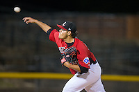 Hickory Crawdads starting pitcher Luis Ortiz (14) delivers a pitch to the plate against the Kannapolis Intimidators at L.P. Frans Stadium on April 23, 2015 in Hickory, North Carolina.  The Crawdads defeated the Intimidators 3-2 in 10 innings.  (Brian Westerholt/Four Seam Images)