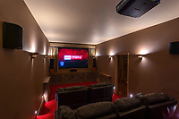 BNPS.co.uk (01202 558833)<br /> Pic: AndyScott/Savills/BNPS<br /> <br /> PICTURED: There's a cinema room for film fans<br /> <br /> A stunning castellated mansion has emerged for sale for £3.75.<br /> <br /> Grade II-listed Worth Hall near Crawley, West Sussex, dates back to the 1840s and is the perfect home for living a luxurious family life.<br /> <br /> It has seven bedrooms, seven bathrooms and five reception areas as well as a billiards room, a cinema and a swimming pool.