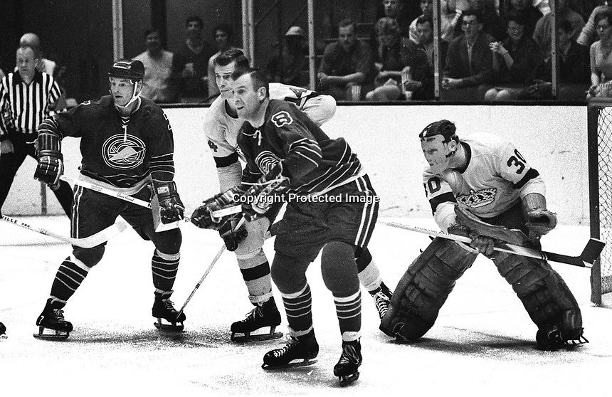 Seals vs Los Angeles Kings: Seals Billy Harris and Gerry Ehrman Kings, Larry Cahan and goalie Wayne Rutledge. (1969 photo/Ron Riesterer)