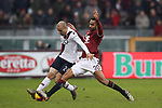 Koffi Djidji of Torino FC challenges Rodrigo Palacio of Bologna during the Serie A match at Stadio Grande Torino, Turin. Picture date: 12th January 2020. Picture credit should read: Jonathan Moscrop/Sportimage