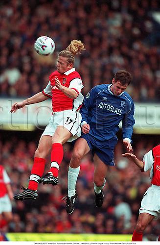 EMMANUEL PETIT beats Chris Sutton to the header, Chelsea 2 v ARSENAL 3, Premier League 991023. Photo:Matthew Clarke/Action Plus...1999.Soccer.football.premiership premier league.club clubs