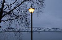 Street light cuts through fog rising above the Ohio River in Marietta, OH.