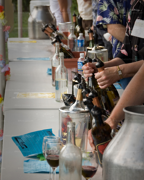 "Volunteers pour tastes of wine during the annual ""Key West Fest"" wine and music festival at Breaux Vineyards in Northern Virginia.  (This photo was published by Destinations Magazine, journal of the American Bus Association, in October 2007.)"