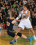 SPEARFISH, SD - MARCH 1, 2016 -- Kassidy Scott #30 of Black Hills State and Ali Meyer #23 of Colorado Christian tangle for a loose ball during the RMAC Shootout Quarterfinals Tuesday evening at the Donald E. Young Center in Spearfish, S.D.  (Photo by Dick Carlson/Inertia)
