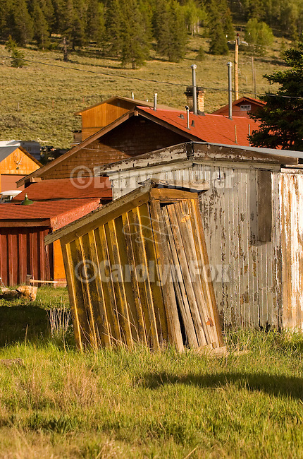 Leaning wooden outhouse in a small town in the Rocky Mountains of Colorado.