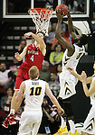 Iowa's Gabriel Olaseni (0) hauls down a rebound against Davidson's Tyler Kalinoski (4) during 2015 NCAA Division I Men's Basketball Championship March 20, 2015 at the Key Arena in Seattle, Washington.  Iowa beat Davidson 83-52.   ©2015. Jim Bryant Photo. ALL RIGHTS RESERVED.