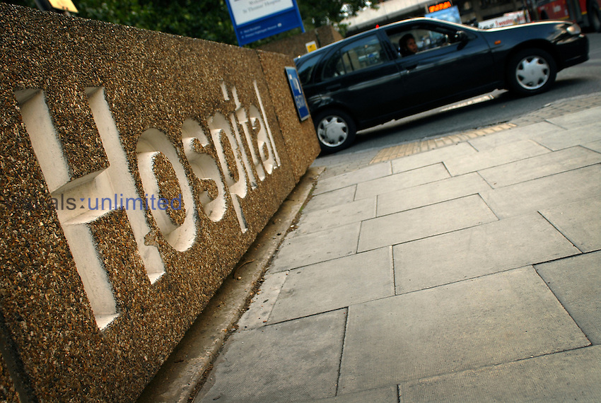 "Engraving of the word ""Hospital"" on a ouside wall at St. Thomas's Hospital, London. St. Thomas' Hospital was founded almost 900 years ago, in the 12th century, the hospital is now part of the Guy's & St Thomas' NHS Foundation Trust and continues to work as a teaching hospital alongside Guy's Hospital. Royalty Free"
