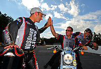 May 6, 2012; Commerce, GA, USA: NHRA pro stock motorcycle rider Eddie Krawiec (left) celebrates with crew chief Matt Hines after winning the Southern Nationals at Atlanta Dragway. Mandatory Credit: Mark J. Rebilas-