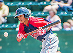 8 July 2014: Lowell Spinners infielder Deiner Lopez lays down a bunt single in the 6th inning against the Vermont Lake Monsters at Centennial Field in Burlington, Vermont. The Lake Monsters rallied in the 9th inning to defeat the Spinners 5-4 in NY Penn League action. Mandatory Credit: Ed Wolfstein Photo *** RAW Image File Available ****