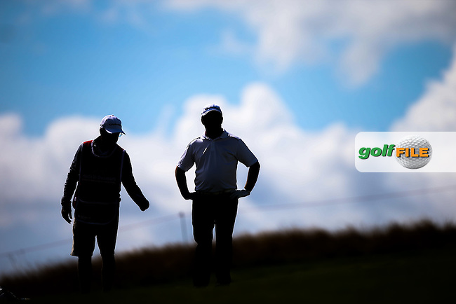 Silhouette of Damien McGrane (IRL) and caddie Pete Futcher during Round Two of the Made in Denmark 2014 Pro-Am from the Himmerland Golf & Spa Resort, Aalborg, Denmark. Picture:  David Lloyd / www.golffile.ie