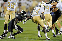 17 September 2011:  FIU defensive back Jose Cheeseborough (27) tackles UCF wide receiver Quincy McDuffie (14) in the second half as the FIU Golden Panthers defeated the University of Central Florida Golden Knights, 17-10, at FIU Stadium in Miami, Florida.
