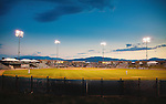 stadium lights on during a rookie league baseball game with the missoula osprey in missoula, montana