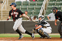 Justin Dalles #9 of the Delmarva Shorebirds follows through on his swing against the Kannapolis Intimidators at Fieldcrest Cannon Stadium on May 21, 2011 in Kannapolis, North Carolina.   Photo by Brian Westerholt / Four Seam Images