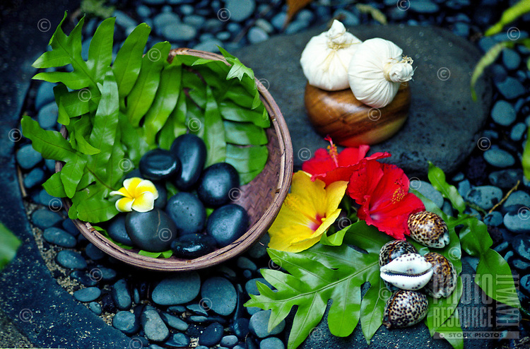 Still life of assorted items used for treatments at the Mauna Lani spa-Pohaku stones, Thai herbal pouches, & shells