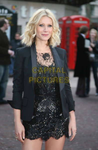 "GWYNETH PALTROW .Attending the ""Iron Man"" UK Film Premiere at the Odeon, Leicester Square, London, England, .24th April 2008..half length black dress lace mini jacket blazer.CAP/DS.©Dudley Smith/Capital Pictures"
