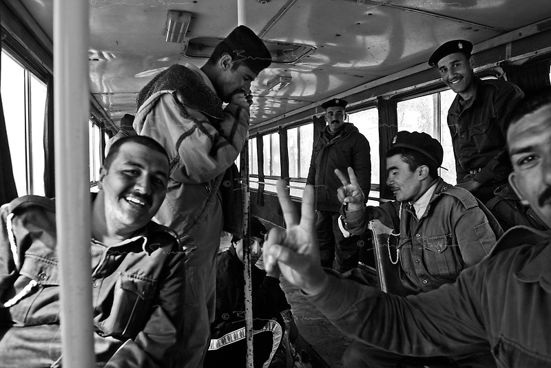 Al Tajih, Iraq, March 01, 2003.Iraqi soldiers on leave board a bus for the ride home.