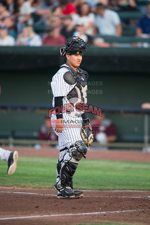 Idaho Falls Chukars catcher Jesus Atencio (31) during a Pioneer League game against the Great Falls Voyagers at Melaleuca Field on August 18, 2018 in Idaho Falls, Idaho. The Idaho Falls Chukars defeated the Great Falls Voyagers by a score of 6-5. (Zachary Lucy/Four Seam Images)