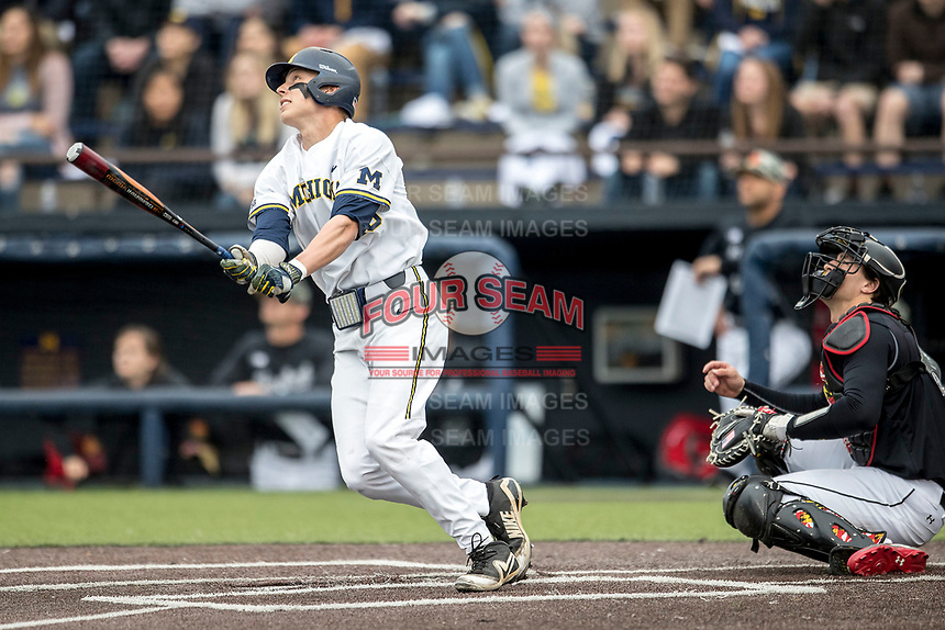 Michigan Wolverines third baseman Blake Nelson (10) follows through on his swing against the Maryland Terrapins on April 13, 2018 in a Big Ten NCAA baseball game at Ray Fisher Stadium in Ann Arbor, Michigan. Michigan defeated Maryland 10-4. (Andrew Woolley/Four Seam Images)