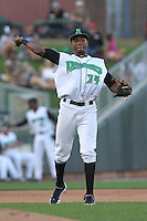 Dayton Dragons third baseman Junior Arias #24 throws during a game against the Lake County Captains at Fifth Third Field on June 25, 2012 in Dayton, Ohio. Lake County defeated Dayton 8-3. (Brace Hemmelgarn/Four Seam Images)