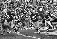 Oakland Raiders sweep with Gene Upshaw, Pete Banazak, with handoff from Daryle Lamonica. (1969 photo by Ron Riesterer)