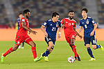 Doan Ritsu of Japan (C) is followed by Ahmed Al Mahaijri (L) and Harib Al Saadi of Oman (2nd R) during the AFC Asian Cup UAE 2019 Group F match between Oman (OMA) and Japan (JPN) at Zayed Sports City Stadium on 13 January 2019 in Abu Dhabi, United Arab Emirates. Photo by Marcio Rodrigo Machado / Power Sport Images