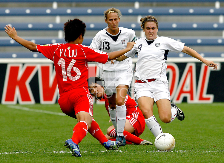 USA forward Heather O'Reilly (9) and China defender Liu Yali (16) battle for the ball.  The U.S. Women's National Team defeated China 4-1 at Toyota Park in Bridgeview, IL on August 28, 2006.