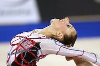 September 21, 2007; Patras, Greece;  Elizabeth Paisieva of Bulgaria turns pirouette (same image, close up cropping) with clubs during All-Around final at 2007 World Championships Patras.  Betty helped Bulgaria to receive the 2nd of 2 positions for the individual All-Around at Beijing 2008 Olympics.  Photo by Tom Theobald. .