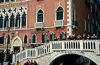 Crowds of tourists on a bridge during carnival, Venice, Italy.
