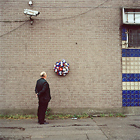 Tommy stands looking at a wreath placed for murdered Ulster Defence Association (UDA) men Steven Goatley and John Fulton on the York Road in a loyalist part of Belfast. They were both killed by the Ulster Volunteer Force (UVF) during a loyalist feud in 1975..