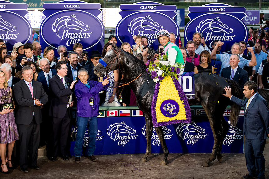 ARCADIA, CA - NOVEMBER 05: Mike Smith, aboard Arrogate #10, pose for a photograph in the winner's circle after winning after winning the Breeders' Cup Classic during day two of the 2016 Breeders' Cup World Championships at Santa Anita Park on November 5, 2016 in Arcadia, California. (Photo by Douglas DeFelice/Eclipse Sportswire/Breeders Cup)