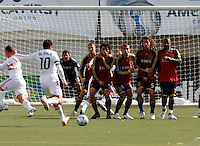 Cuauhtemoc Blanco (10) of the Chicago Fire strikes a free kick as Real Salt Lake goalkeeper Nick Rimando (18) and a wall of  Chris Wingert (17), Fabian Espindola (9), Yura Movsisyan (14), Kyle Beckerman (5) and Andy Williams (77) defend. The Chicago Fire and Real Salt Lake played to a 1-1 tie during a Major League Soccer match at Rice-Eccles Stadium in Salt Lake City, Utah on March 29, 2008.