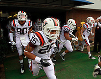 CHARLOTTESVILLE, VA- NOVEMBER 12: Virginia Tech Hokie players run onto the field before the game against the Virginia Cavaliers on November 28, 2011 at Scott Stadium in Charlottesville, Virginia. Virginia Tech defeated Virginia 38-0. (Photo by Andrew Shurtleff/Getty Images) *** Local Caption ***