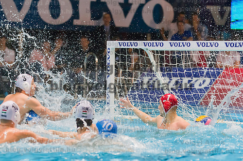Hungary's Norbert Madaras scores a goal against Italy's goalkeeper Giacomo Pastorino during the Volvo Water Polo Cup in Szekesfehervar, Hungary on January 07, 2012. ATTILA VOLGYI