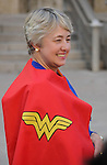 Mayor Annise Parker sports a super-hero cape on the steps of City Hall Monday April 13, 2015. She was presented the gift before a reading of a proclamation of April as Child Abuse Prevention Month.(Dave Rossman photo)