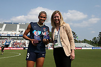 Cary, North Carolina  - Saturday April 29, 2017: Lynn Williams is presented with the 2016 MVP and Golden Boot awards by Deputy Commissioner Amanda Duffy prior to a regular season National Women's Soccer League (NWSL) match between the North Carolina Courage and the Orlando Pride at Sahlen's Stadium at WakeMed Soccer Park. The Courage won 3-1.