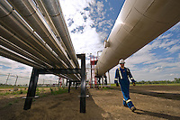 Production foreman, Ron Toly, visually inspects the carbon capturing research facility near Redwater, Alberta on June 26, 2009.  Eventually waste carbon dioxide would be pipelined to a similar site, however currently large cylindrical tanks store, drink grade, CO2  prior to pumping the liquified gas into the ground, for permanent storage.
