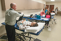NWA Democrat-Gazette/ANTHONY REYES • @NWATONYR<br /> Dr. David Taylor, Associate Professor of Physical Therapy at University of Arkansas for Medical Sciences, demonstrates testing procedures with physical therapy student Paris Richardson Thursday, Dec. 10, 2015 at the school in Fayetteville. Richardson and other students were in a lab reviewing course material for their upcoming final exams. The school is finishing its first semester in Fayetteville.