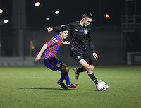 Thomas Reilly pressures Eoghan O'Connell in the St Mirren v Celtic Clydesdale Bank Scottish Premier League U20 match played at St Mirren Park, Paisley on 18.12.12.