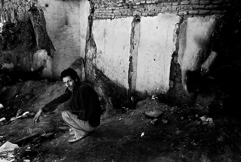 Teheran, Iran, April 16, 2007.Derelict buildings in the old part of the city are 'home' to hundreds if not thousands of heroine addicts like Hamid. The Iranian government is trying hard to curb the smuggling of opium through the Afghan/Iran border, especially by improved cooperation with the Afghan government but the scale of the problem remains huge.